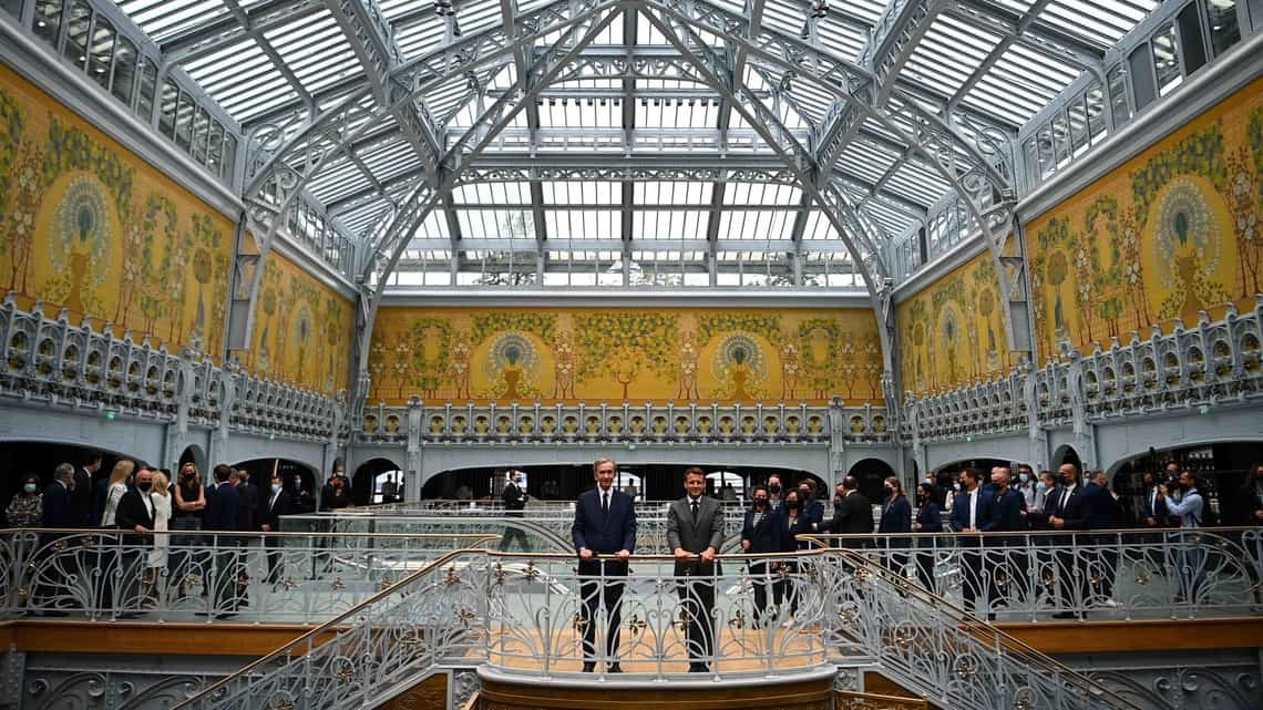 French President Emmanuel Macron (right) and head of French multinational corporation LVMH Bernard Arnault attend a ceremony marking Paris' 'La Samaritaine' reopening on 21 June in Paris.