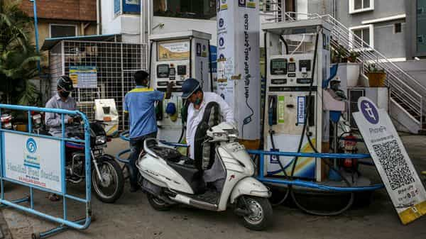 Motorcyclists refuel at a Bharat Petroleum Corp. gas station in Bengaluru (Bloomberg)