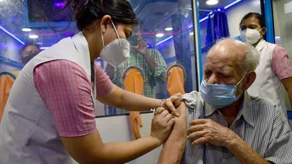 Covid vacciantion in Delhi: A beneficiary receives the dose of the COVID-19 vaccine during a vaccination on wheels, at Connaught place.