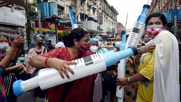 Members of Left-wing students participate in a demonstration against fake COVID-19 vaccine issue, in Kolkata. (PTI)