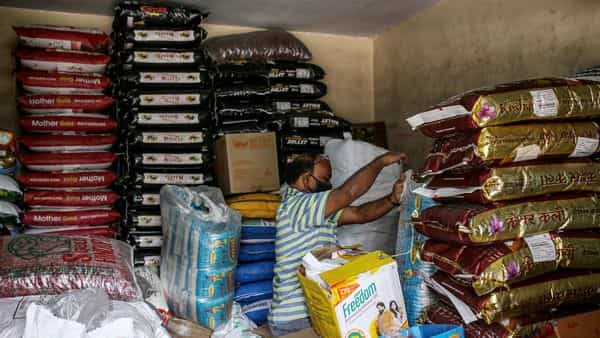 A shopkeeper arranges stock at a grocery store, known as a kirana. (Bloomberg)