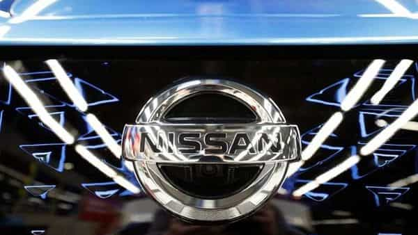 The logo of Nissan is seen on a car. (REUTERS)