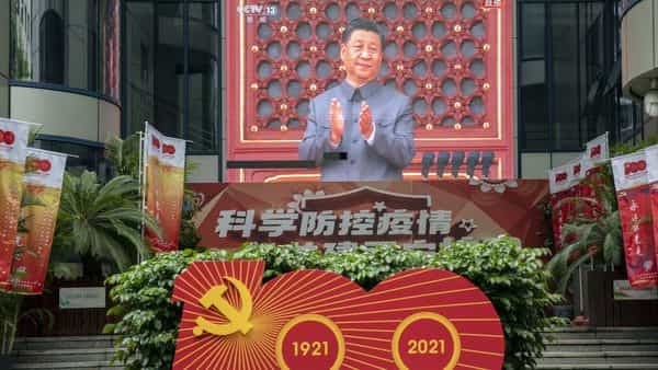 A screen shows a live news broadcast of Chinese President Xi Jinping at a ceremony marking the centenary of the Chinese Community Party, (Bloomberg)