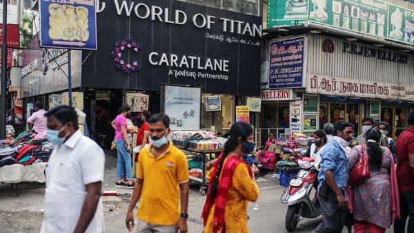 Pedestrians walk past stores in Chennai, India. (Bloomberg)