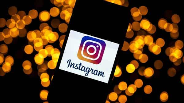 This file photo shows the logo of Instagram on a smartphone. The social media platform is testing a feature that will that would let creators offer exclusive stories to their followers.