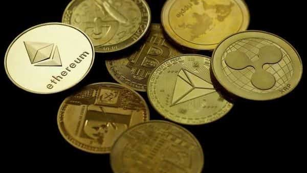 A representation of the virtual cryptocurrency Ethereum is seen among representations of other cryptocurrencies in this picture illustration (REUTERS)