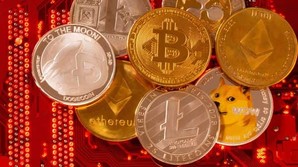 Representations of cryptocurrencies Bitcoin, Ethereum, DogeCoin, Ripple, Litecoin are placed on PC motherboard in this illustration (REUTERS)