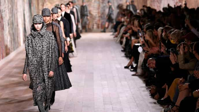 Models parade for Christian Dior at the end of the Women's Fall-Winter 2021-2022 Haute Couture collection fashion show in Paris on 5 July.
