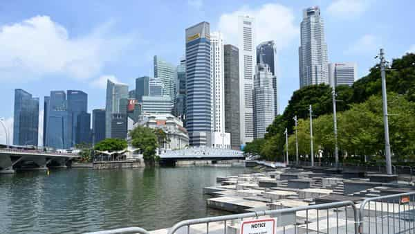 Last month, Trade and Industry Minister Gan Kim Yong said more migrant workers and foreign domestic helpers will soon be allowed to enter Singapore to work, (AFP)
