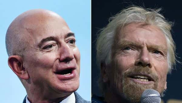 This combination of file pictures shows Blue Origin founder Jeff Bezos (L)  and Virgin Group founder Sir Richard Branson. (AFP)