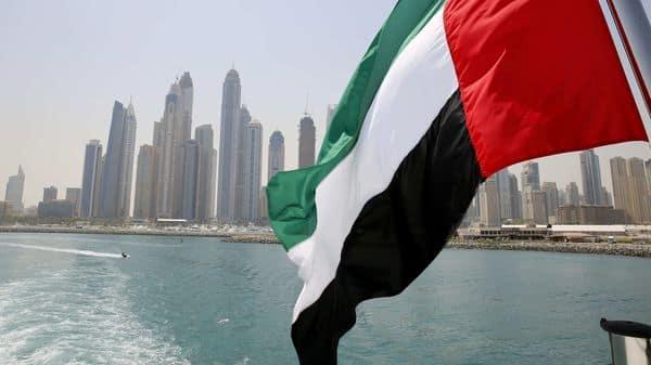 UAE flag flies over a boat at Dubai Marina (REUTERS)