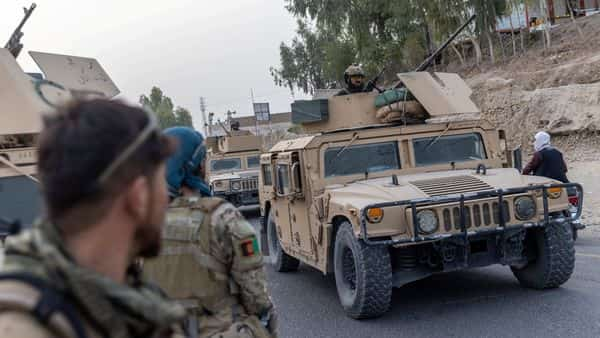A convoy of Afghan Special Forces is seen during the rescue mission of a police officer besieged at a check post surrounded by Taliban, in Kandahar province, Afghanistan,  (REUTERS)