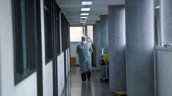 A healthcare worker walks at an intensive care unit of a hospital during the coronavirus disease (COVID-19) pandemic. (REUTERS)