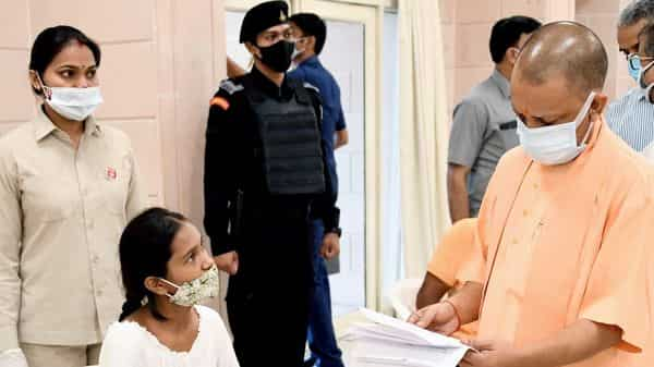 Uttar Pradesh Chief Minister Yogi Adityanath reviews the grievances of people during janta darshan at his official residence, in Lucknow.
