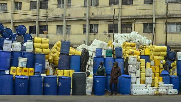 Traders sell used industrial plastic containers. (AFP)