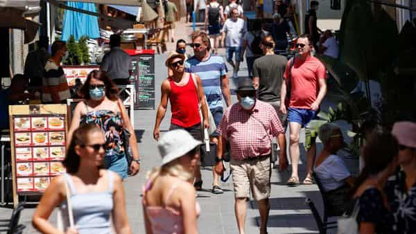 People walk at a pedestrian area in Sitges town, south of Barcelona, Spain, (File photo)