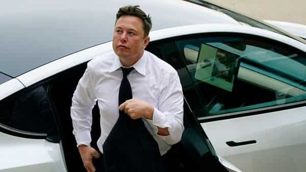 Elon Musk arrives at the justice center in Wilmington. (AP)