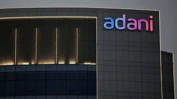 The logo of the Adani Group is seen on the facade of one of its buildings on the outskirts of Ahmedabad, India. (REUTERS)