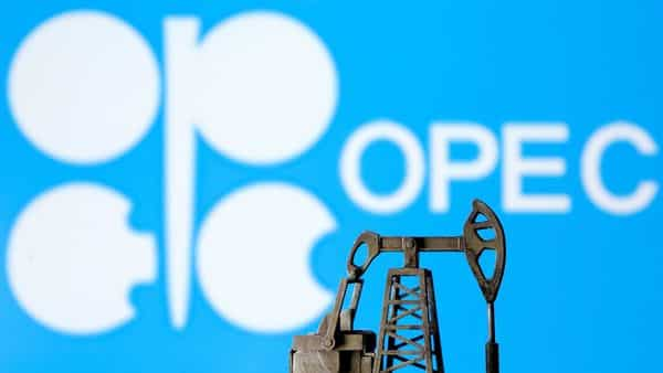 A 3D printed oil pump jack is seen in front of displayed Opec logo in this illustration picture. (REUTERS)