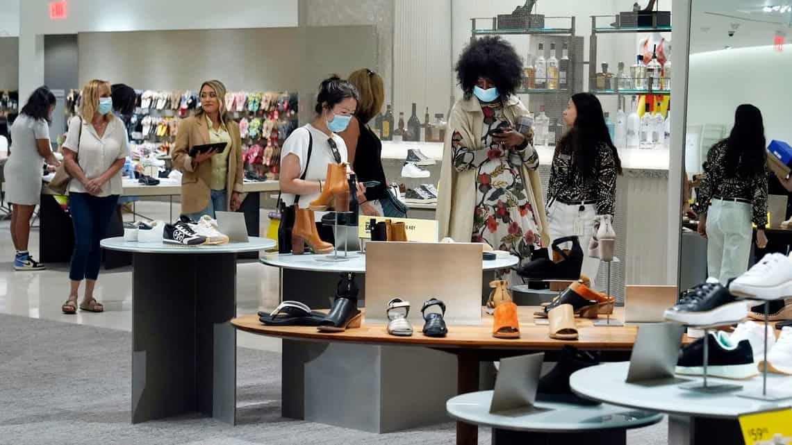 Shoppers browse a shoe department at the Nordstrom NYC Flagship store, in New York.