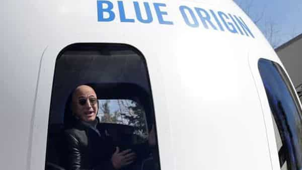 Bezos stepped down as Amazon CEO in July, allowing him more time for side projects including his space exploration company Blue Origin. (REUTERS)