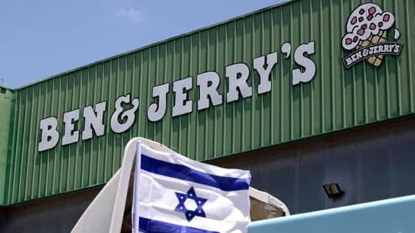 An Israeli flag is set atop a delivery truck outside US ice-cream maker Ben & Jerry's factory in Be'er Tuvia, on July 21, 2021 (Photo: AFP)