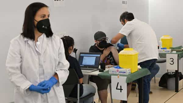 A person receives a dose of J&J Covid-19 vaccine in a vaccination truck. (AFP)
