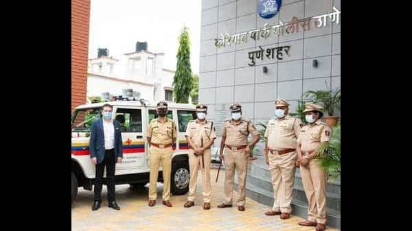 Mr. Poonawala presenting a new jeep to the Police personnel as a token of appreciation