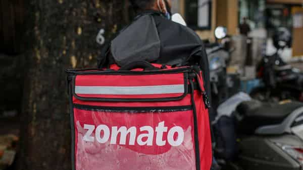 Zomato delivery rider waits to collect an order in Mumbai, India, (Bloomberg)