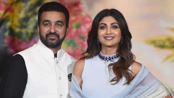 Bollywood actress Shilpa Shetty and her husband Raj Kundra pose for a picture. (AFP)