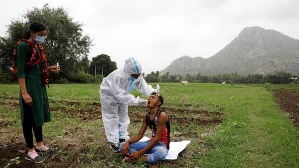 FILE PHOTO: Healthcare workercollects a swab for a rapid antigen test from farmer  (REUTERS)