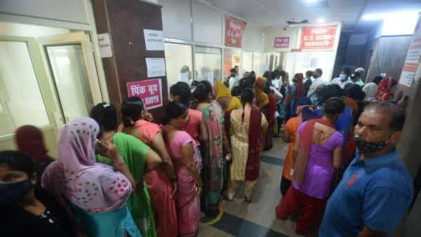 Women in a queue to get Covid-19 vaccinations at Sector 30 district hospital, in Noida