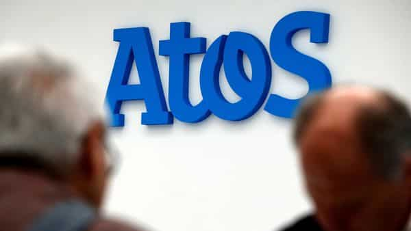 People walk in front of the Atos company's logo in Paris (REUTERS)