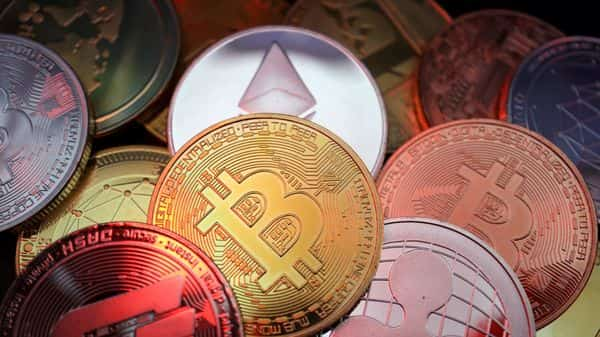 FILE PHOTO: Representations of cryptocurrencies including Bitcoin, Dash, Ethereum, Ripple and Litecoin are seen in this illustration picture (REUTERS)
