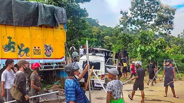 Assam-Mizoram border dispute: A file photo of locals near damaged security force vehicles after clashes at Lailapur in Cachar district (Photo: PTI)
