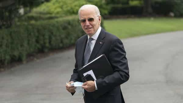 U.S. President Joe Biden walks on the South Lawn of the White House after arriving on Marine One in Washington, D.C., U.S. (Bloomberg)