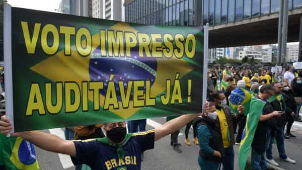 Demonstrators take part in a rally in support of Brazilian President Jair Bolsonaro and calling for a printed vote model at Paulista Avenue in Sao Paulo. (AFP)