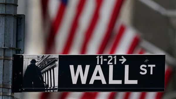 Dow Jones Industrial Average was trading flat after hitting an intra-day record high earlier in the day (AP)