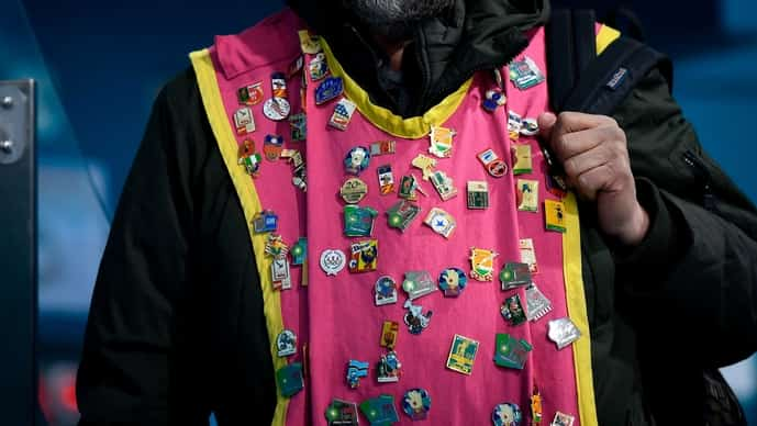 A fan wearing Olympic pins at the 2018 Winter Games.