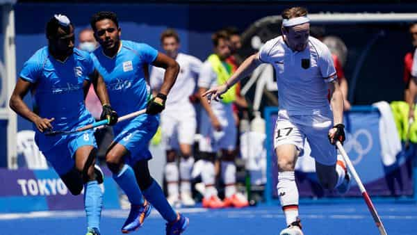 Germany's Jan Christopher Ruhr (17) makes a fast break against India's Hardik Singh (8) and Harmanpreet Singh (13) during the men's field hockey bronze medal match at the 2020 Summer Olympics, (AP)