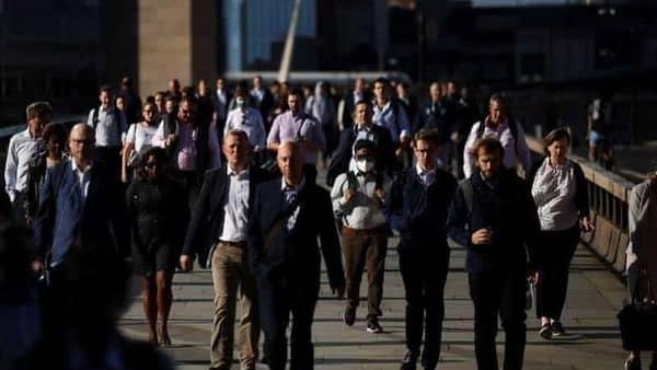 People walk over London Bridge during morning rush hour, amid the coronavirus disease (COVID-19) pandemic in London. (REUTERS)