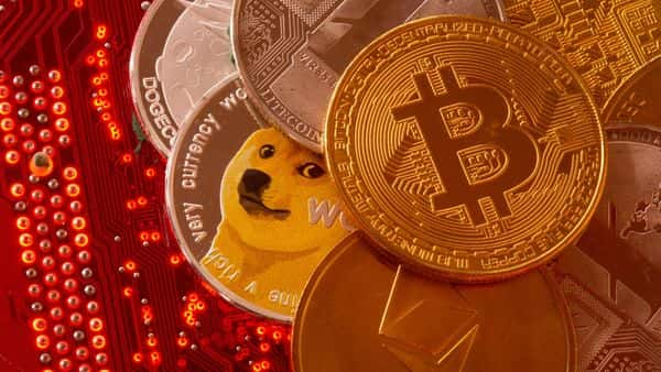 cryptocurrencies Bitcoin, Ethereum, DogeCoin, Ripple, Litecoin representations are placed on PC motherboard in this illustration (REUTERS)
