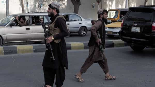 Taliban fighters guard a check-point on a main street in Kabul, Afghanistan. (REUTERS)