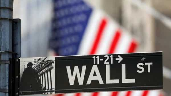 A street sign for Wall Street is seen outside the New York Stock Exchange (NYSE) in New York City, New York, U.S. (REUTERS)