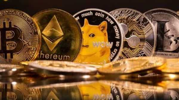 cryptocurrencies Bitcoin, Ethereum, DogeCoin, Ripple, and Litecoin representations are seen (REUTERS)