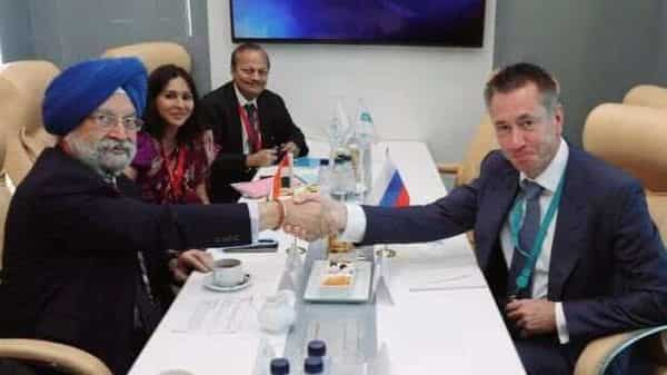 Petroleum minister Hardeep S Puri (Left) with PJSC Sibur chairman Dmitry Konov in Russia, (Twitter/ Ministry of Petroleum and Natural Gas)