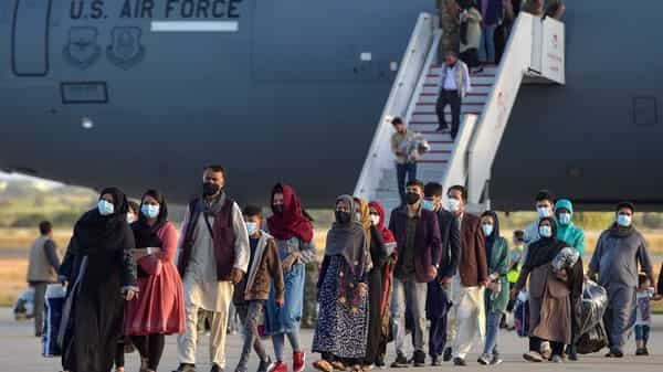Afghan refugees disembark from a US air force aircraft after an evacuation flight from Kabul (Photo: AFP)