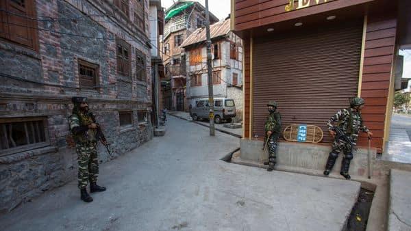 Paramilitary soldiers guard a deserted street in Srinagar, Sunday. (AP)