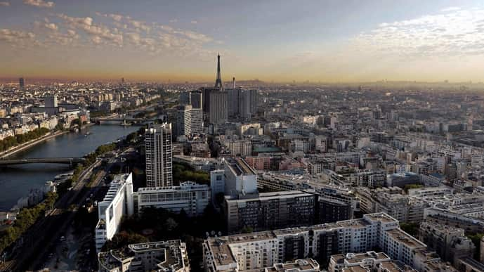 This aerial file photograph shows western Paris, the Seine river and the Eiffel Tower (C), with air pollution visible in the background on September 15, 2020.