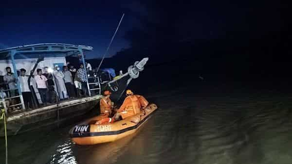 Assam boat accident: NDRF conducts a rescue operation as two boats carrying approximately 120 passengers collided in the Brahmaputra river in Jorhat on Wednesday. (ANI Photo) (ANI)